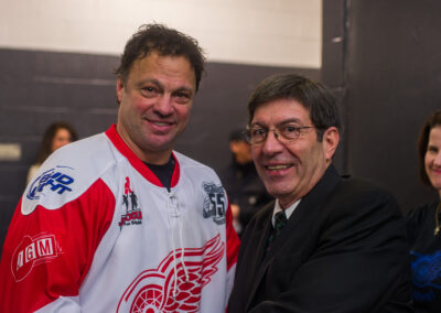 Dino Ciccarelli and Jim Alban taking a photo together